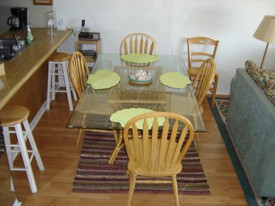Dining area between open galley kitchen and family room. All with beach view.