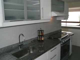 Miraflores condo photo - The Kitchen Features both Ocean and City Views