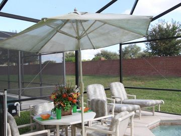 Shaded outdoor table. Perfect place to relax and enjoy a refreshing drink.