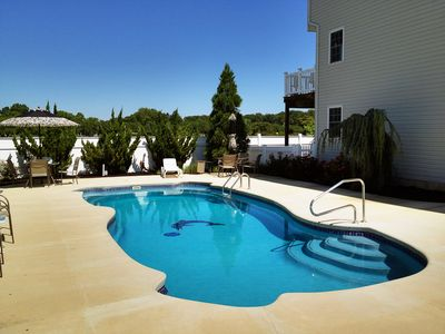 Pool area with townhome in background.