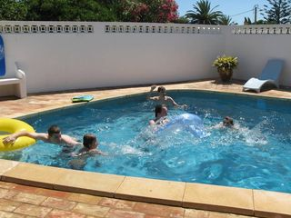 Our kids enjoying Casa da Figueira's large private heated swimming pool - Praia da Luz Area villa vacation rental photo