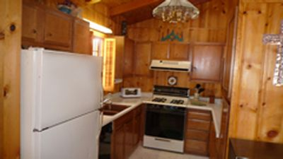 Equipped kitchen with dishwasher, microwave, electric stove, and fridge