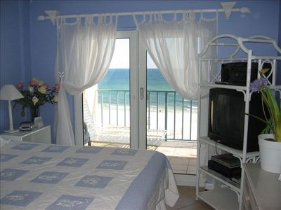 King Master suite with balcony  beach & Gulf on other side of French doors