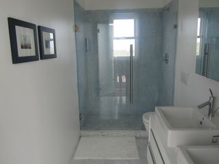 Governor's Harbour villa photo - Upstairs Bathroom with all glass shower, designer fixtures and view of Sky beach