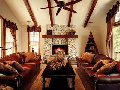 Relax in the Great Room a with a wood burning fireplace.