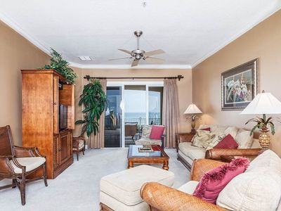 Bask in the sunlight in our tropically elegant living room - Bask in the warm sunlight in our elegantly decorated living room. The carved wood furniture and tropical accents will enchant you. Cinnamon Beach is a sophisticated Florida beach rental.
