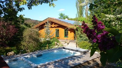 Fantastic wooden house with barrel saunas, swim spa, wooden terrace and paradise garden