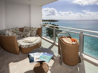 Cupecoy condo photo - Oceanfront patio off the Master bedroom