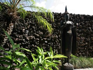 Mauna Lani villa photo - Lava rock and lush foliage