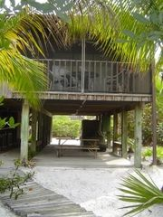 Don Pedro Island condo photo - Covered lower deck w/ picnic table, hammock, laundry room