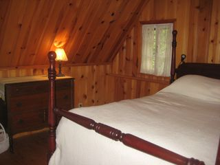 Saint-Sauveur cabin photo - The Master Bedroom with antique mahogany bed.