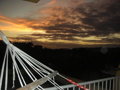 Sunset Over Mountains from the Hammock on Rooftop Penthouse