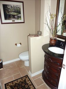 Half bath convenient to dining and great room.