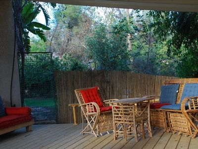 private deck in the garden, great place for eating and reading near forest trail