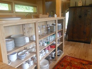 Mezzano barn photo - The open credenza, an antique plate rack from St. Anthony's of Padua