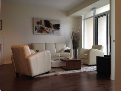 White Leather Living Room in bright open space