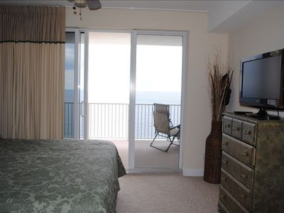 Master Bedroom w/ Direct Access to Balcony. Wake up and see the ocean from bed!