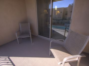 Upstairs balcony overlooks pool and has great mountain views!