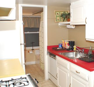 The galley kitchen includes all full sized appliances. 1 of 2 baths is adjacent