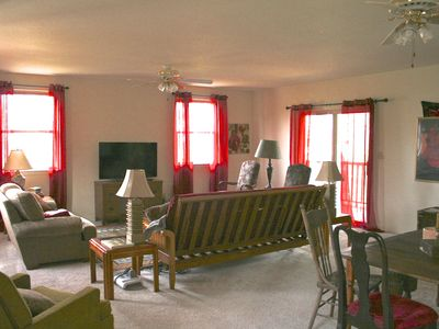 Large family room, big screen TV, DVD, Direct TV, 2nd table for games or dining