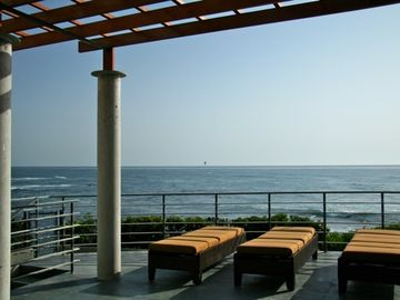 Breathtaking views from the private large back patio that's right on the Ocean!