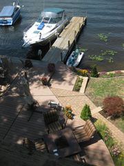 View from upper balony to decks and dock below - Bolton Landing house vacation rental photo
