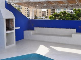 San Juan apartment photo - Swimming pool with BBQ and bench to sit and relax
