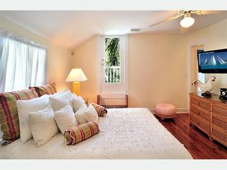 Key West house photo - The Nantucket Bedroom 1: Flat screen TV & a private sundeck right outside.