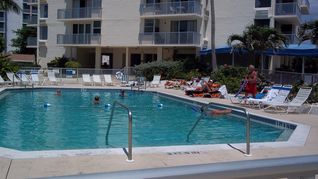 Fort Myers Beach condo photo - Go for a swim in the heated pool.