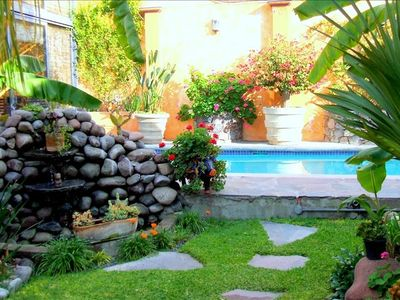Outside Handicapped Accessible GARDENS with lap pool, waterfall and plants