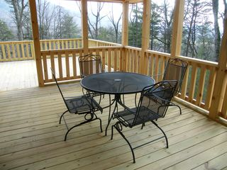 Luray cabin photo - covered porch with rocking steel chairs and gas grill