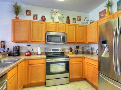 Kitchen with brand new Samsung stainless steel appliances.