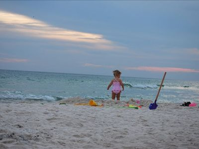 Our daughter Zoey enjoying the softest white sand in America