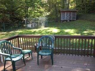 Goodview house photo - back deck, fenced yard, and a dog pen