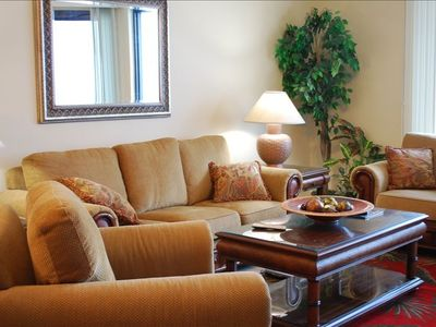 Living Room with queen sleeper sofa and flat screen TV