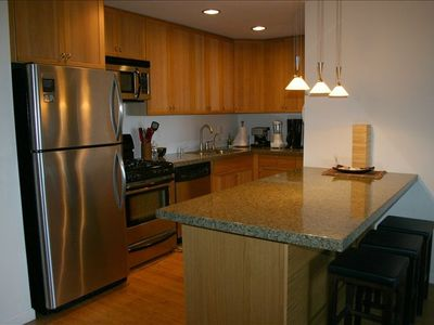 Updated kitchen with dishwasher, oven/range, refrigerator, microwave, granite co
