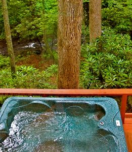 Relax in the hot tub & listen to the rushing waters