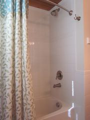 South Bethany Beach house photo - A bathroom with tub & shower and double sinks.