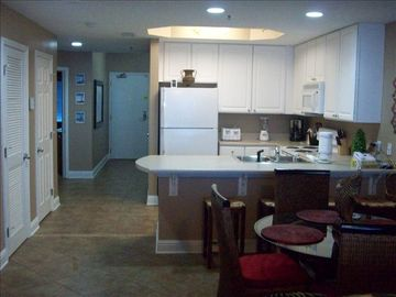 Dining area, kitchen, entrance hall with beautiful new tile throughout