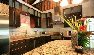 Beautiful modern Commercial Kitchen with Roman Granite counter tops.