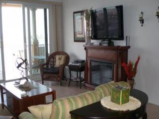 Clearwater Beach condo photo - Living Room to Balcony / LCD T.V 62 inch over Working Electric Fireplace.