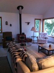 Curtis cottage photo - The comfortable living room with a gorgeous view of Big Manistique Lake