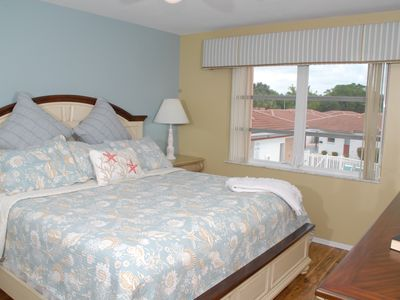 Master bedroom with brand new king bed, ceiling fan, beautiful view