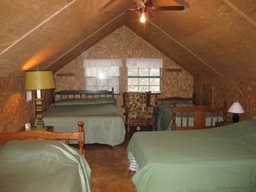 Upstairs loft with queen, full, and 2 twin beds