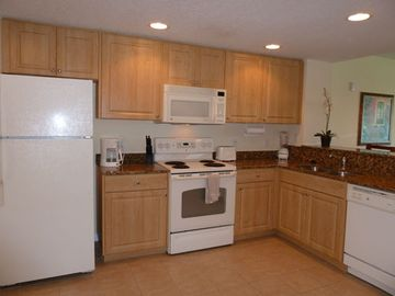 Full sized kitchen, granite countertops & w/d in unit.