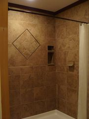 West Wardsboro house photo - Stone tiled Master Bath shower is ever so spacious with antique oak vanity.