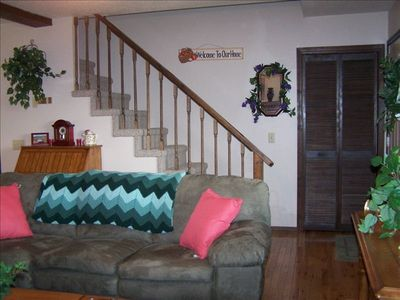 A LARGE BEDROOM AND THE TWIN ROOM ARE LOCATED UP STAIRS.