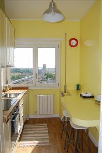 A fully equipped kitchen with dishwasher