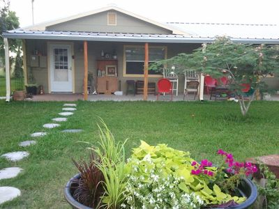 Austin farmhouse rental - front covered wrap-around porch with plenty of seating