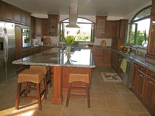 Nosara villa photo - Spacious kitchen opens to the outside dining area